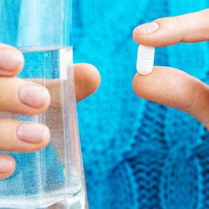 woman-taking-vitamin-d