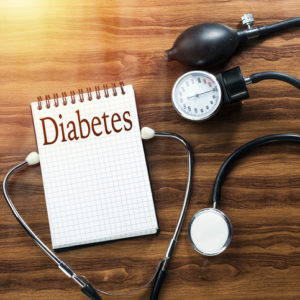 diabetes on notepad with stethoscope