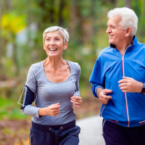 smiling couple jogging