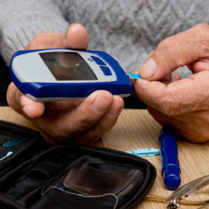man using glucometer